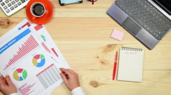 Woman Monitoring Stock Graphs Stock Footage