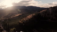 Aerial: Rural Valley @ Sunset with Mountain Vistas, Great Light in Fall Setting Stock Footage