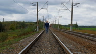 Man walking on the railroad Stock Footage