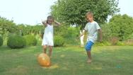 Children burst balloon in the garden Stock Footage
