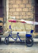 Rickshaw (bicitaxi) in old Havana street Stock Photos