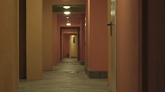 fleeing man and woman in a deserted corridor Stock Footage