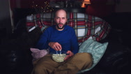 4k Authentic Shot of a Funny Man Watching Movie and Eating Popcorn Stock Footage