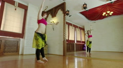 The red-haired young attractive girl performing a belly dance. Wide angle. 4K Stock Footage