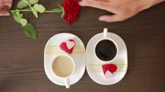 Man and woman on a date at a cafe. drink coffee and cake. gives flowers Stock Footage