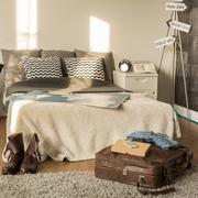 Traveler bedroom with decorative signpost Stock Photos