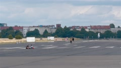 Real Time locked down shot of People at Tempelhofer Feld in Berlin Stock Footage