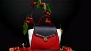 Handbag on black background Stock Footage