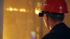 Steel Plant. Worker Monitors Melting in Blast Furnance Stock Footage