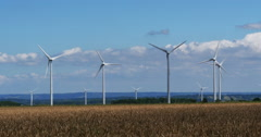 Wind Turbines with Blue Sky, near Caen in Normandy, Real Time 4K Stock Footage