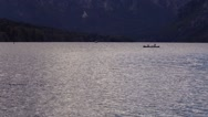 Unrecognizable couple kayaking on Bohinj lake in Slovenia Stock Footage