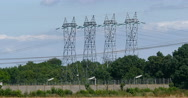 Electricity pylons with Blue Sky, near Caen in Normandy, Real Time 4K Stock Footage