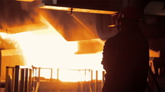 Steel Plant. Tank with the Liquid Metal and Worker Stock Footage