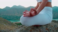 4K beautiful girl in Lotus white clothes doing yoga on the beautiful backdrop of Stock Footage