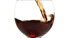 Red Wine being poured into Glass, against White Background, Slow motion Stock Footage