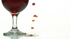Red Wine being poured near Glass, against White Background, Slow motion Stock Footage