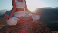 4K yoga in the mountains,a beautiful girl dressed in white ,sun,sun flare, slow Stock Footage