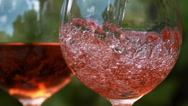 Pink Wine being poured into Glass, Slow motion Stock Footage