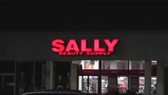 4k Sally beauty supply retail storefront Stock Footage