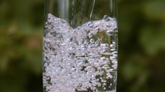Water being poured into Glass, Slow Motion Stock Footage