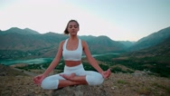 4K yoga in the mountains,a beautiful girl dressed in white ,early morning, slow Stock Footage