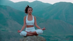 4K yoga in the mountains,a beautiful girl dressed in white ,early, morning Stock Footage