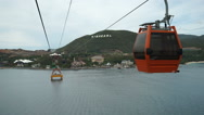 Bird's-eye view from a high cabin which is moving on ropeway of the funicular to Stock Footage