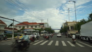 View from a car which moves on the road to central street of tourist city in Stock Footage