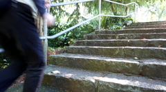 Close up woman jogging stairs in Queen Elizabeth park Stock Footage
