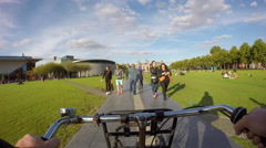 Bicycling on Museumplein, Amsterdam Stock Footage