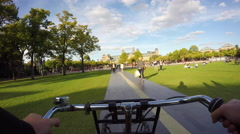 Riding a bike on Museum square, Amsterdam. Stock Footage