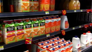 Motion of display drinks and cheese inside Walmart store Stock Footage