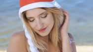 Portrait of cute girl in santa hat smiling. Slowly Stock Footage