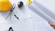 Top view male hands laying out blueprints on the white table lit by the sun Stock Footage
