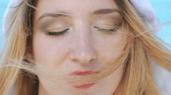 Portrait of woman's face with moving hair on head. Slowly Stock Footage