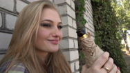 Upset drunk Girl Blonde drinking Beer from a Bottle against the Wall Stock Footage
