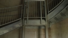 Spiral Staircase in Abandoned Silo Tilt Stock Footage