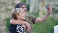 Married couple on vacation doing a selfie Stock Footage