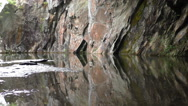 Colourful rock reflection on the water Stock Footage