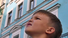 Worried face little boy lost city Stock Footage