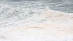 Slow motion panning shot amazing ocean waves on shore in a storm Stock Footage