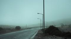 Foggy mountain asphalt road,moody, overcast Stock Footage