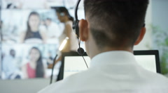 4K Business group in office engaged in conference call with many colleagues Stock Footage