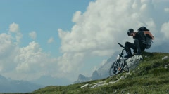Mountain Biker Resting and Enjoying Great Mountain Vista. Stock Footage