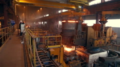 Steel Plant. Blast Furnance. Workers. Sparks and Flashes. Wide Stock Footage