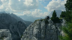 Resting Biker on the Mountain Cliff. Stock Footage