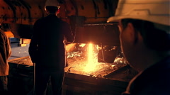 Steel Plant. Workers near Blast Furnance. Sparks and Flashes Stock Footage