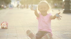 Cute girl soiled with chalk, having fun and show her dirty hands to the camera Stock Footage