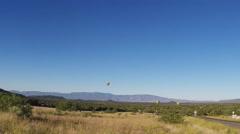 Distant Hot Air Balloons Drifting Over Verde Valley- Sedona Arizona Stock Footage