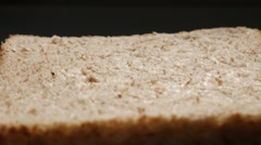 Full grain bread for toasting close-up surface 4K Stock Footage